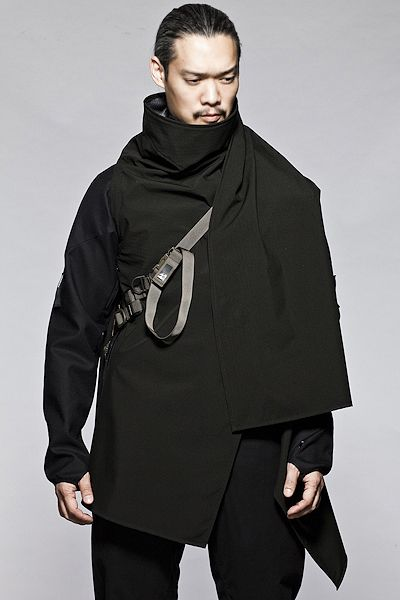 The SS-CP1 Cloak by Acronym. A different piece from Acronym because of the slight lack of functionality. It doesn't cover as effectively as a jacket. However if you ever wanted to look like you were from the future this is it.