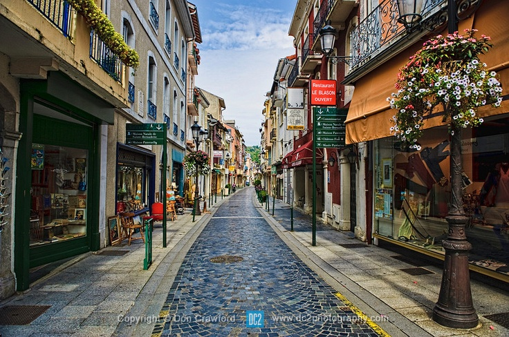 One of the quaint streets in Lourdes France. Lourdes is a small market town lying in the foothills of the Pyrenees, famous for the Marian apparitions of Our Lady of Lourdes that are reported to have occurred in 1858 to Bernadette Soubirous.