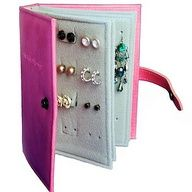 Love this! Earring Book:  felt, cardboard, hot glue and hole puncher. Great for traveling!