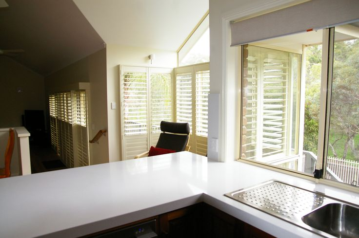 Loving the plantation shutters in this kitchen.