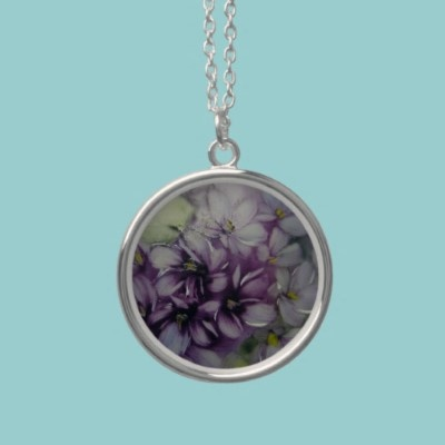 Painted Violets Necklace  Beautiful necklace with a delicate painting of violets. A wonderful gift for the lady in your life.  $32.90