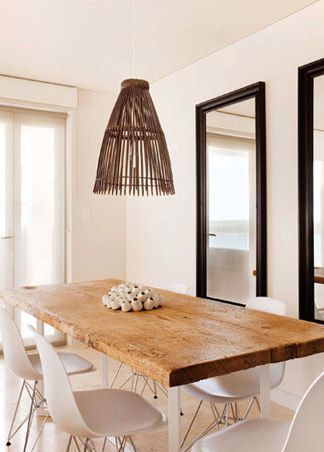 love the wood slab topped dining table with the white eiffel chairs. great mix of old n new!