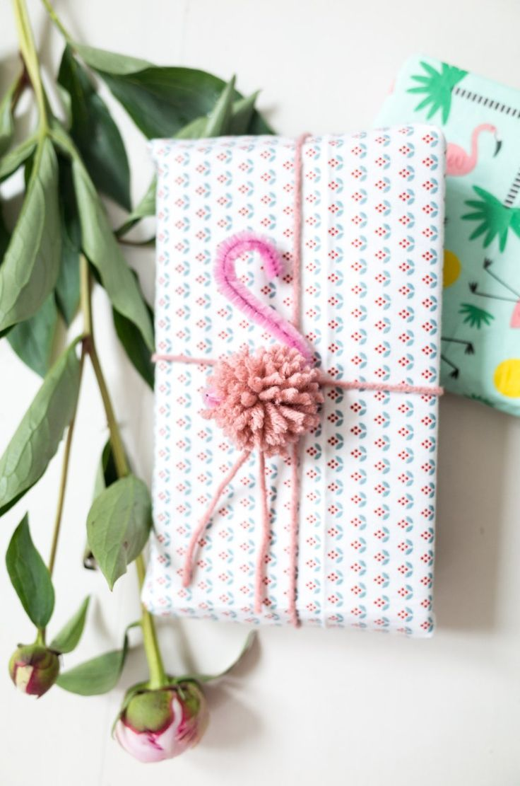 Flamingo Pom Pom Oh my, I LOVE LOVE LOVE this POM POM Cuteness. What a clever little Gift decorating idea - make your own Flaming Pom Poms. I love how quick and easy they are make and yet how fab…