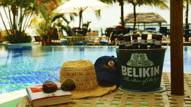Poolside Dining at Chabil Mar Resort Belize. Enjoy Belize local beer, cocktails, breakfast, lunch and dinner. Belize specialties. #belizerestaurants #belizerecipes #restaurantsinbelize #placencia #belizeresorts #centralamericaphotos #photosofbelize #belikin #alfrescodiningphotos