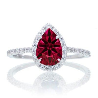Classic Pear Cut Ruby With Diamond Celebrity Engagement Ring. If you are looking for a Ruby gemstone engagement ring set at affordable prices then look no further than this beautiful Ruby and diamond wedding engagement ring. This ring can be customized to 10k 14k or 18k gold.