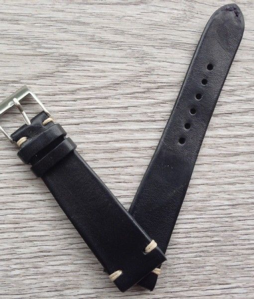 VintageStraps handmade vintage black leather watch strap. Fully customizable (size, ecru stitch color and type, and buckle). $103 USD.