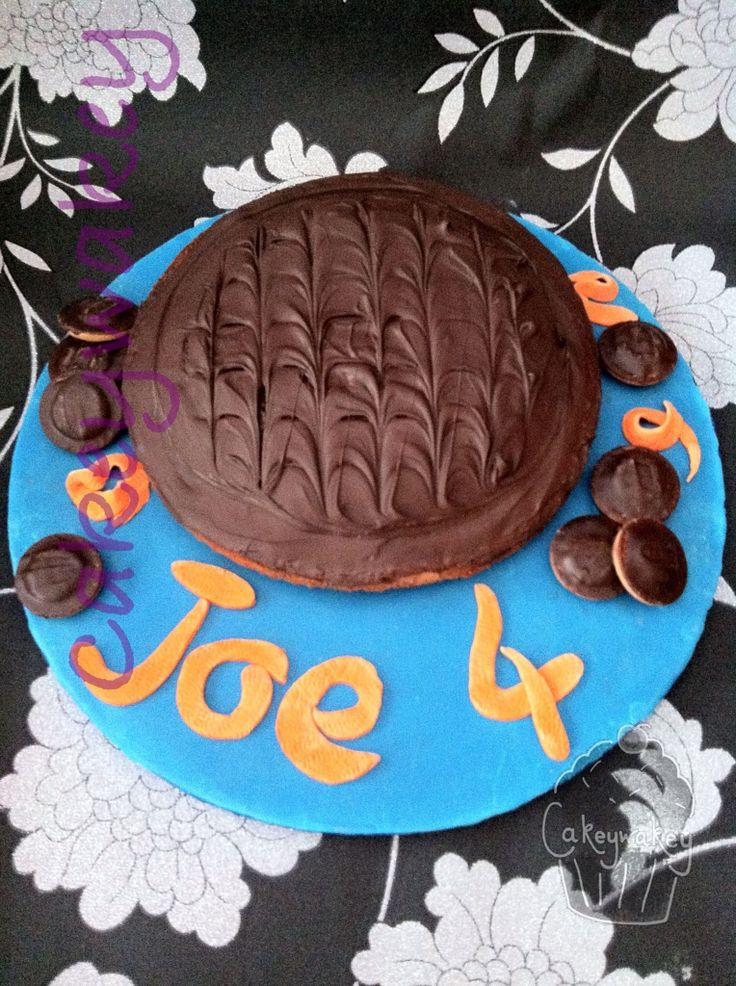 My giant Jaffa Cake birthday cake, finished off with Mini Jaffa Cakes and 'orange peel' fondant letters