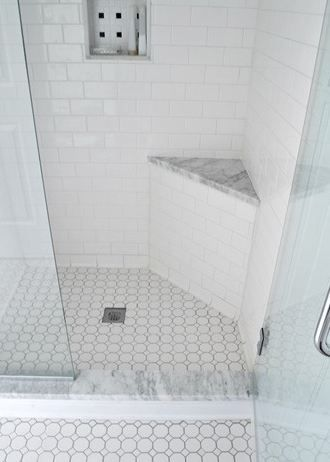Shower Wall: White ceramic subway tile 3 x 6 • Shower Floor: White ceramic octogon with white dots • Accent in Niche: White and Black ceramic pinwheel • Shower curb and Shower Seat: White Carrara marble