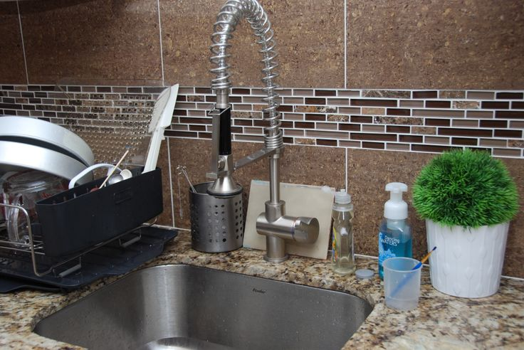 I would have loved a deeper and wider sink but it was out of my budget - solution? Get a faucet that is taller - that way I can still wash big pans.....For the backsplash - the glass tiles are too expensive so we opted for bigger tiles with glass as accents