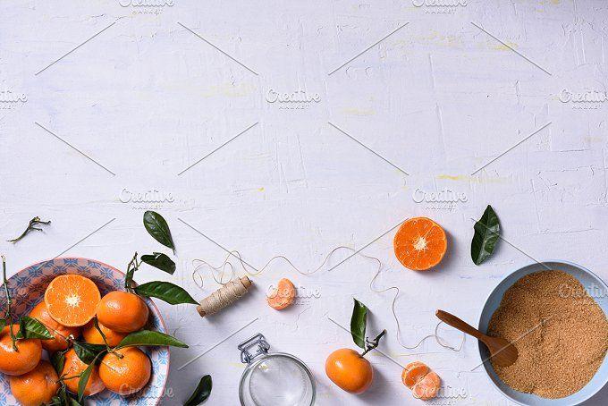 Fresh orange fruits with sugar by Iuliia Leonova on @creativemarket