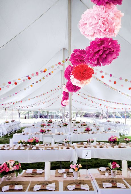 Pink, red, and fuchsia tissue-paper pomanders and banners (Ingalls Photo)