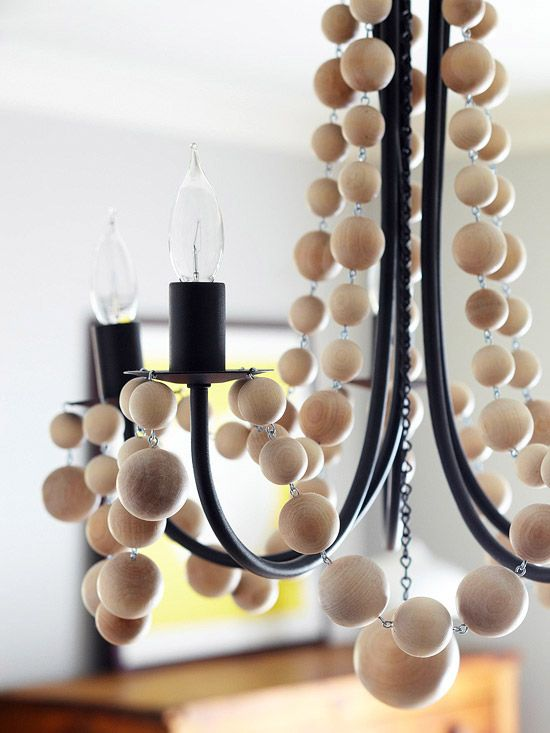 A bit of whimsy was added to a plain chandelier with swags crafted from wooden balls in three sizes. Do it yourself by inserting eyehooks into the balls, stringing them together, and hanging them from the fixture.