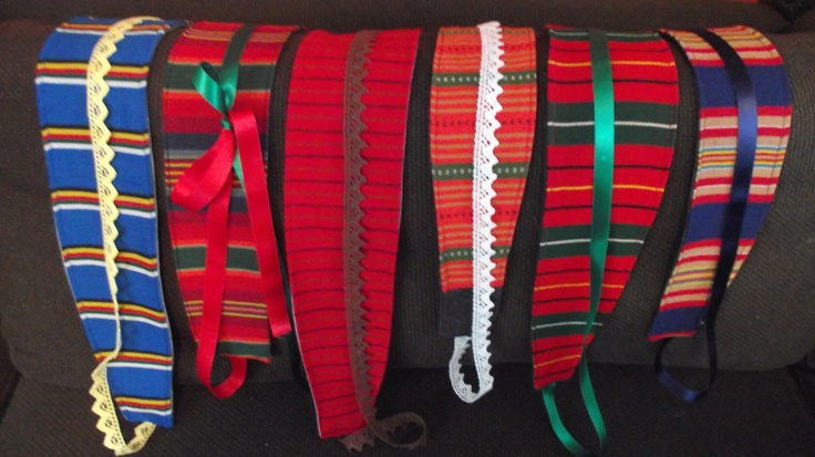 Belts made out of Finnish folk costume materials, recycled jeans and lace/silk ribbons.  @http://www.facebook.com/Kansanomaisetkankaat