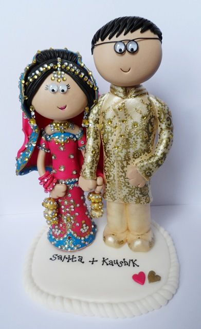 Personalised Indian Bride & Groom cake topper figurines. I make them to look like you in any outfits, this lovely couple are in Pink, blue & gold. A couple like this is £149.99, a base is £9.99 and I send my work anywhere in the World. www.indian-wedding-cake-toppers.com