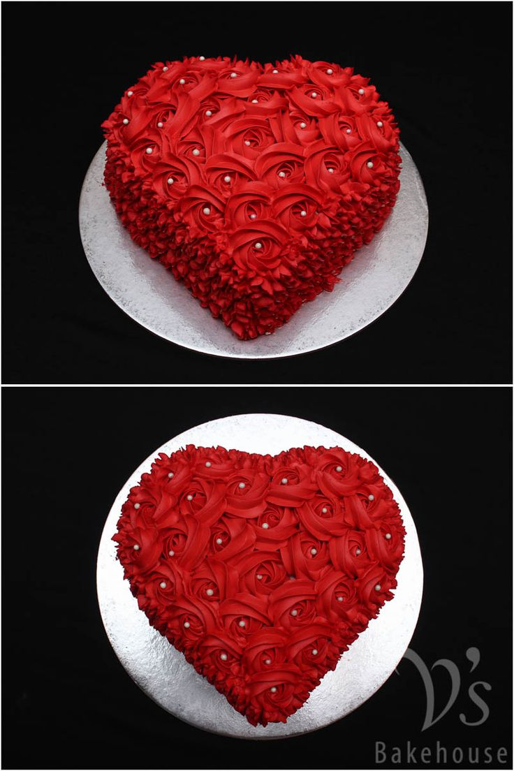 Choco truffle heart cake with red rosettes