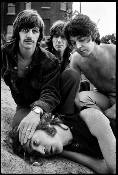 paul is just calmly sitting on john while ringo is holding his face to the gound, and george is just chillin in the background