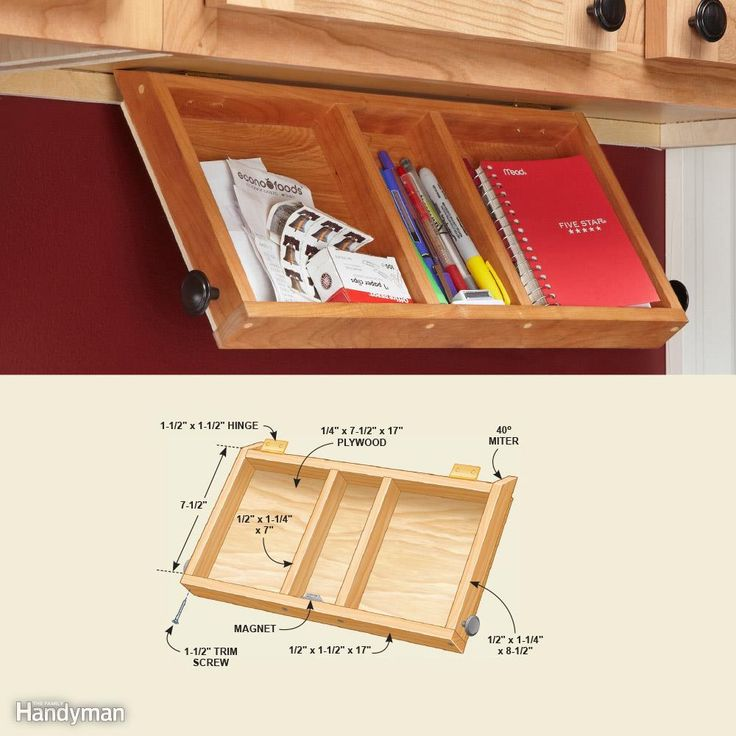 This tray is perfect for pens and paper. When closed, it's mostly hidden by the cabinet face frame. Hinges and magnets hold this tray in place.