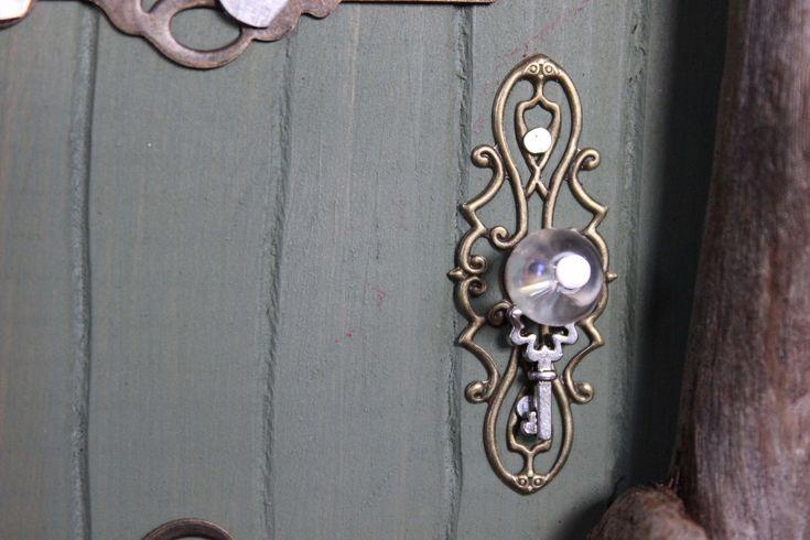 moss green fairy door, doorknob