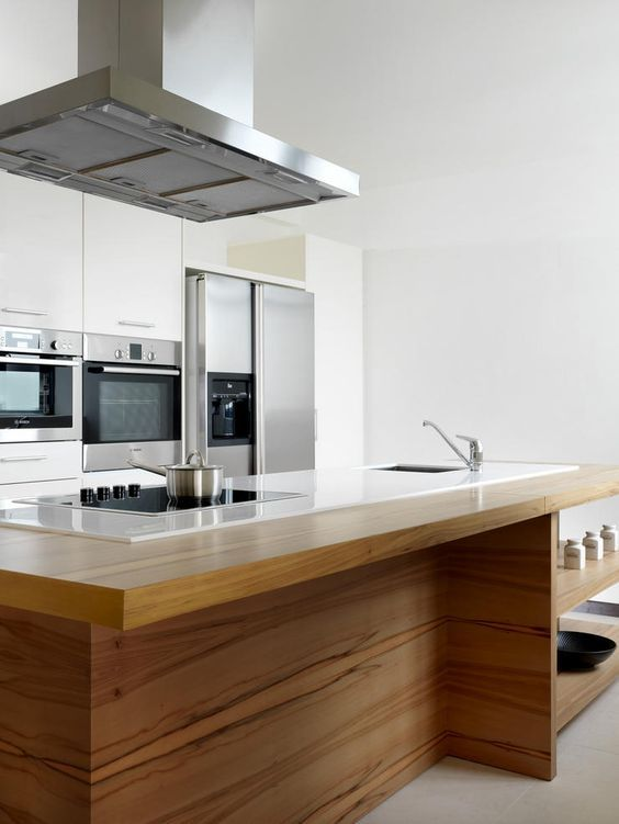 To maximise space, integrate the cooktop into the island, so food preparation and cooking can be done on the same surface.
