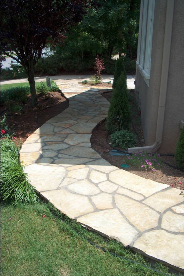 A flagstone walkway that's as flat and cleanly defined as any concrete pathway.