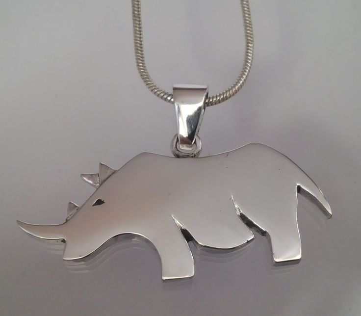 Solid sterling silver rhinoceros on silver chain. The rhino is one of the Big Five animals from Africa and a very popular item to have for your wardrobe.
