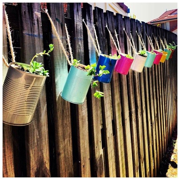 Recycle cans & hang on fence boards for more planting space. Great for yards with limited sunlight.
