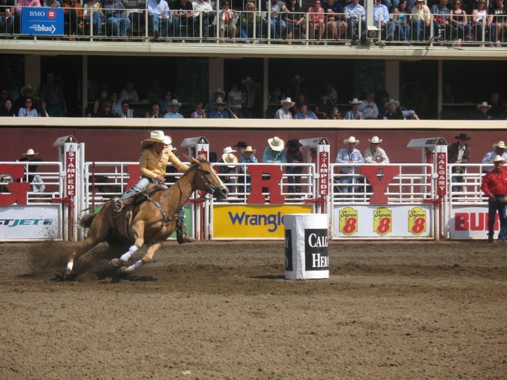 Barrrel Racer completing barrel turn at the Calgary Stampede. For more Stampede info see http://calgary.foundlocally.com/entertainment/fest-stampede.htm