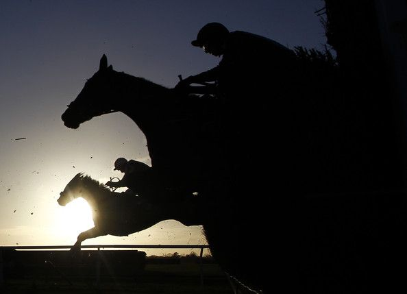 A general view as runners clear a fence at Wincanton racecourse on January 15, 2015 in Wincanton, England. (January 14, 2015 - Source: Alan Crowhurst/Getty Images Europe)