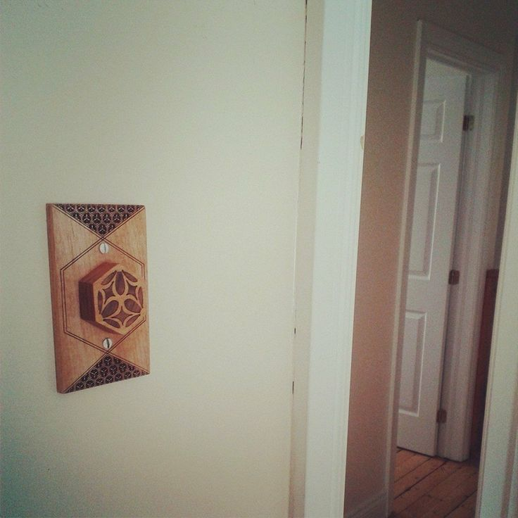 New lightswitch cover and dial in mahogany with laser-cut walnut inlay for my meditation room.