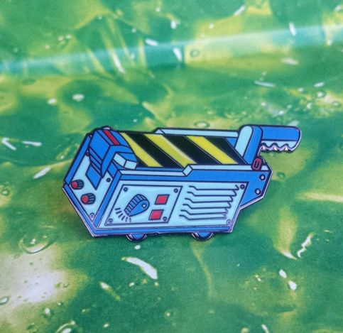 1.5 Hard Enamel Lapel Pin inspired by 1980's hit movie Ghostbusters. Black nickle finish with double posts and rubber clutches.   This edition is based on the toy Ghost Trap released for the cartoon series, The Real Ghostbusters!   Do you believe in UFOs, astral projections, mental telepathy, ES