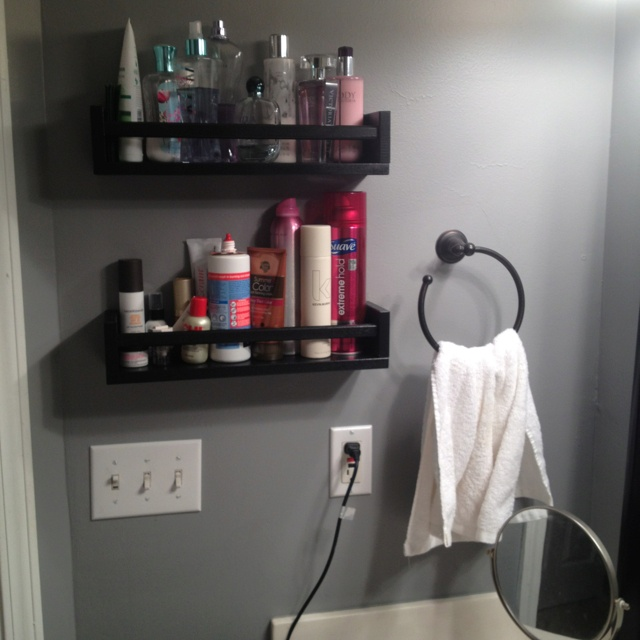Ikea spice racks...perfect for extra storage in your bathroom!