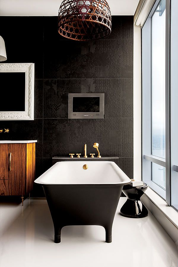 A traditional white on white bathroom gets a glam makeover for Black wall interior