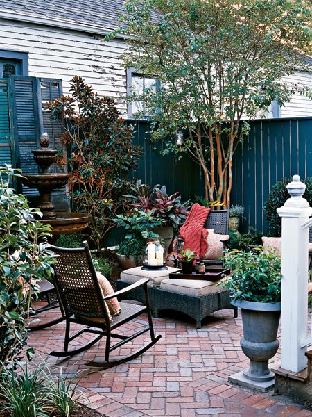 new orleans courtyard designs | While traditional materials like brick, tiered fountains, and magnolia ...
