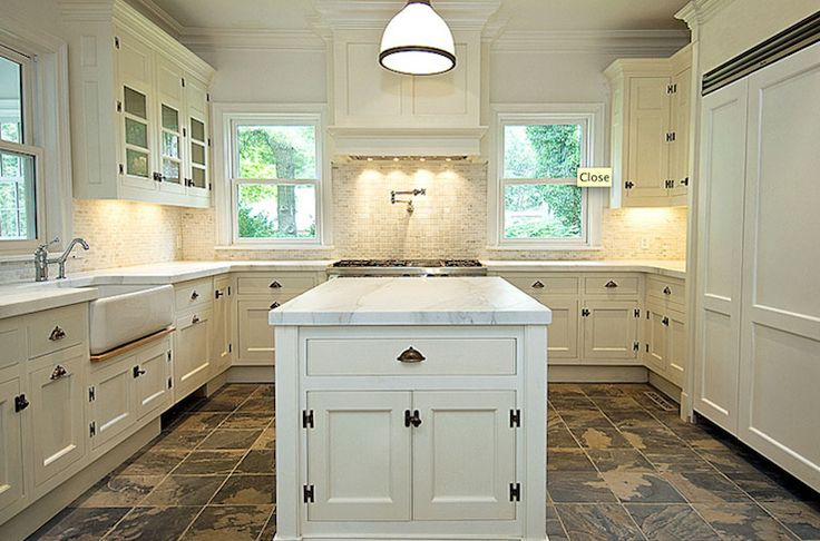 cream color kitchen cabinets and slate floor and company