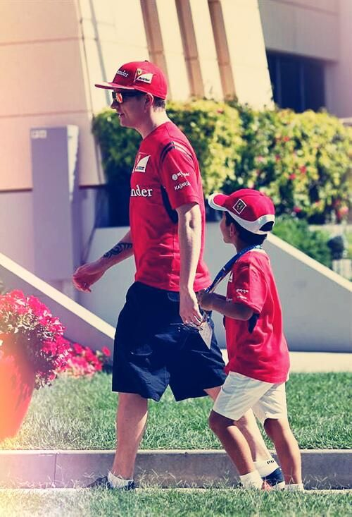 Kimi with a young Ferrari fan in the paddock