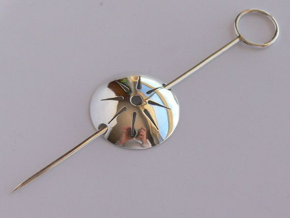 Sterling silver brooch with star / spark / sun / sun by Evesbeads, $75.00