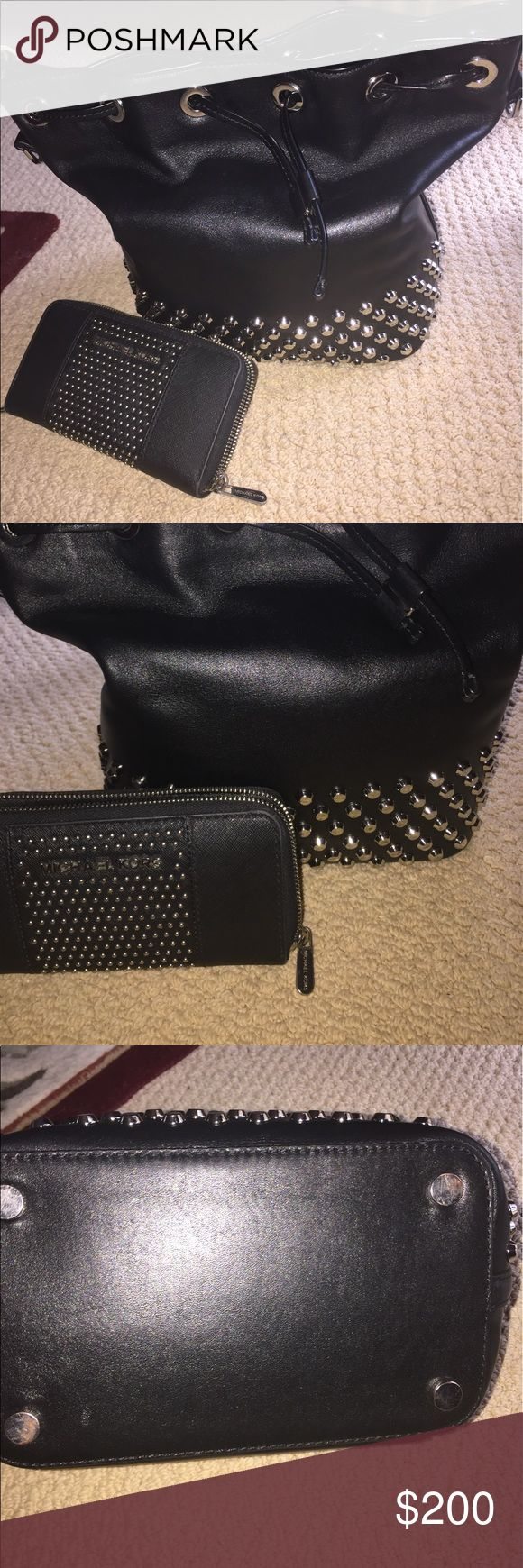 Michael Kors studded purse set Like new Michael Kors  studded  purse set. In great condition the only thing is that the L and Michael fell off the bag Michael Kors Bags Shoulder Bags