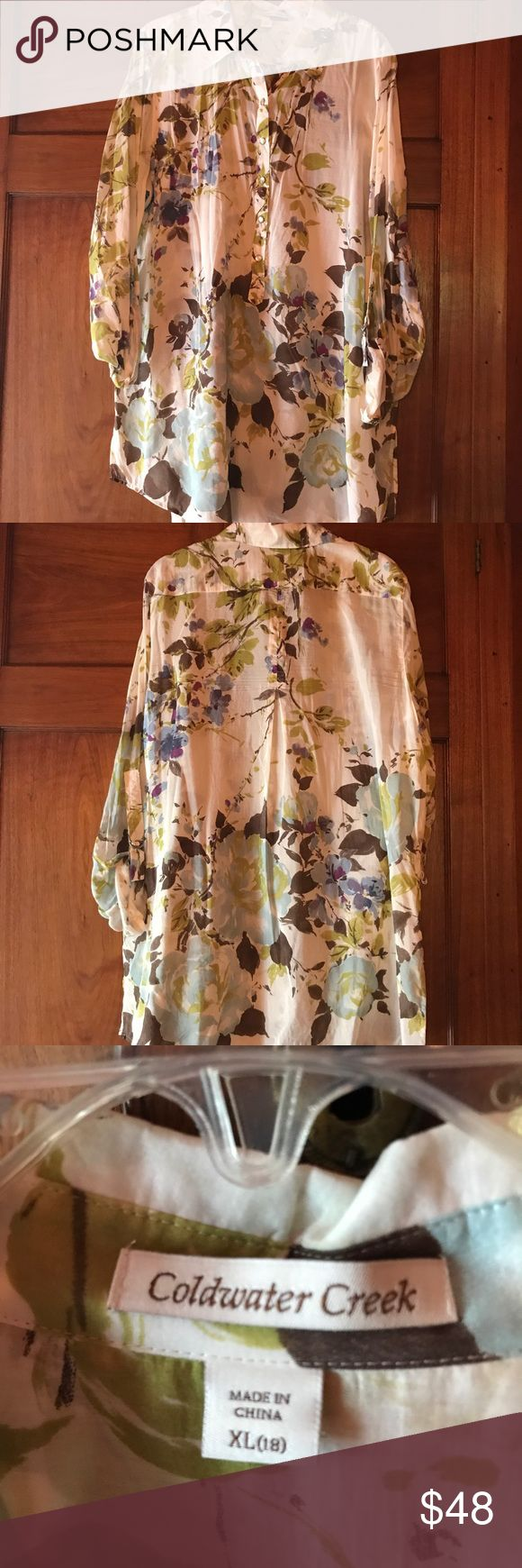 Coldwater creek floral print voile tunic XL NWT Coldwater creek floral print voile tunic size XL or size18. New with tags.Tunic has brown, aqua, lime, blue, and purple flowers on a cream background. The shirt has snap buttons that go halfway down the garment. The sleeves can be rolled up and fastened with a D ring. The government has a split him. There are belt loops but no belt. Please check garment for measurements. Thanks for visiting my closet! Coldwater Creek Tops Tunics