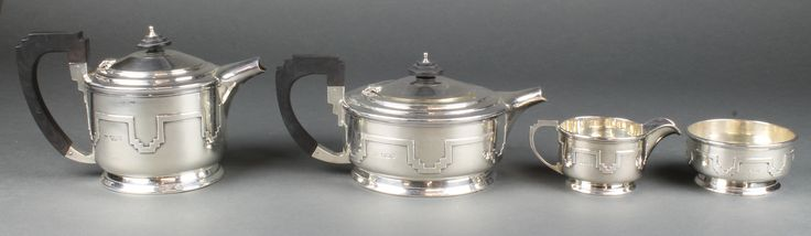 Lot 615, An Art Deco silver 4 piece tea and coffee set with strapwork decoration and ebony mounts, Sheffield 1937 and 1938, gross 1484 grams, est  £400-600