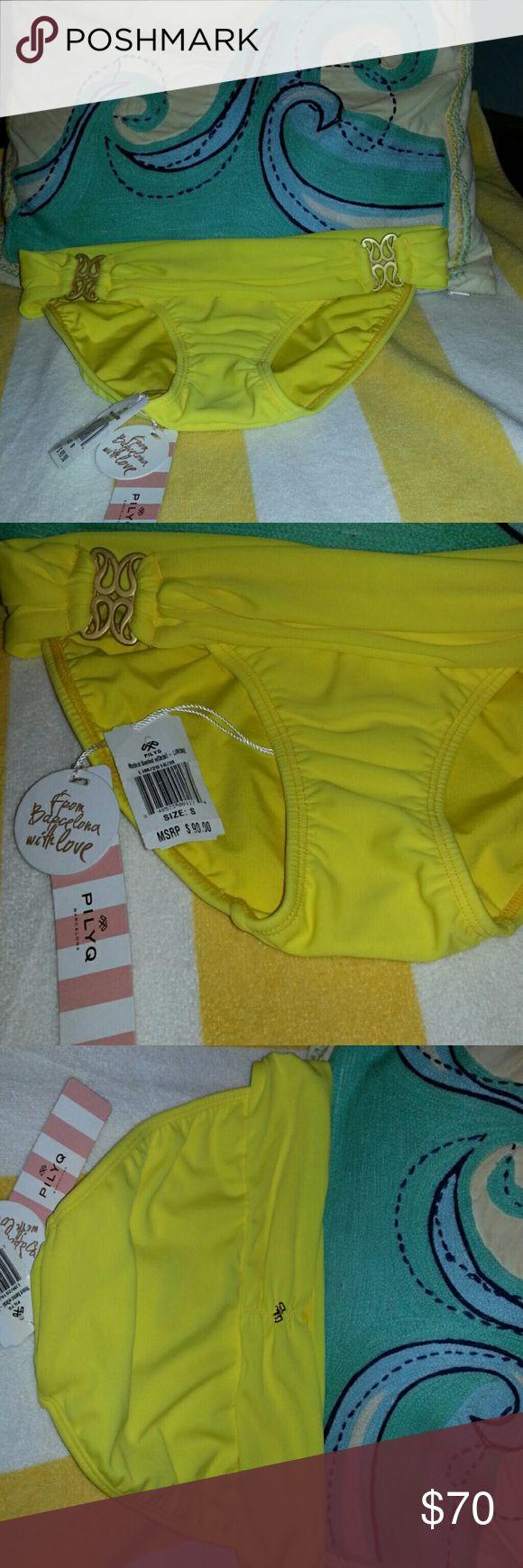 PILYQ BIKINI BOTTOMS SIZE SMALL Bright yellow bikini bottoms with side hip gold emblems and back maker's mark on waistband.. PILYQ Swim Bikinis