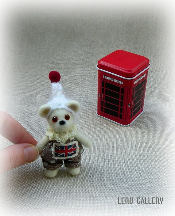 Tiny teddy bear. This small guy from London. Even live in famous red telephone call-box. Can travel in your pocket everywhere. Always ready to make company for you. He is safe in his box. Box size about 6 cm (2.3). Its easy to put in bag or pocket.  Needle felted miniature. Size about 6,5 cm (2.5). Bear needle felted of new-zealand wool. Glass brown eyes with pupils. Cotton pants, hand knitted hat of angora wool. Box include.  If you would like more than one doll in my shop, better add them…