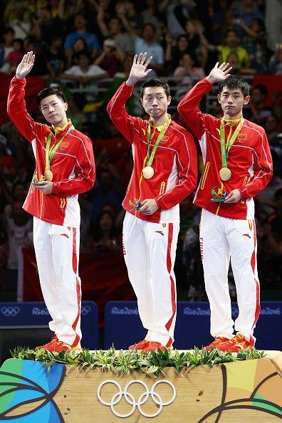 Gold medalists Long Ma Xin Xu and Jike Zhang of China celebrate during the…