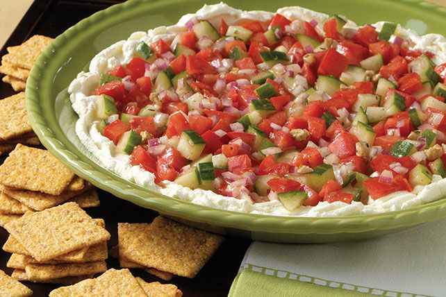 This Mediterranean-style dip gets a great start in the deliciousness department, thanks to a base of softened Neufchatel cheese.