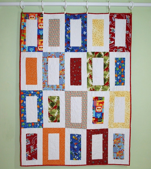 Very neutral dinosaur quilt that he wouldn't outgrow too fast