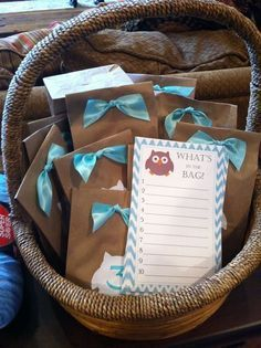 For this cute baby shower game, just fill bags with small items from mom-to-be's registry: pacifiers, diaper cream, mittens, etc...and then have everyone guess what's inside! #babyshowergames #babyshowerfun #babyshower