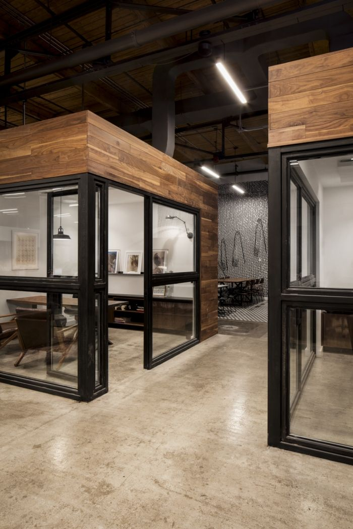 These glass-walled workrooms provide personal space without feeling stifled or claustrophobic