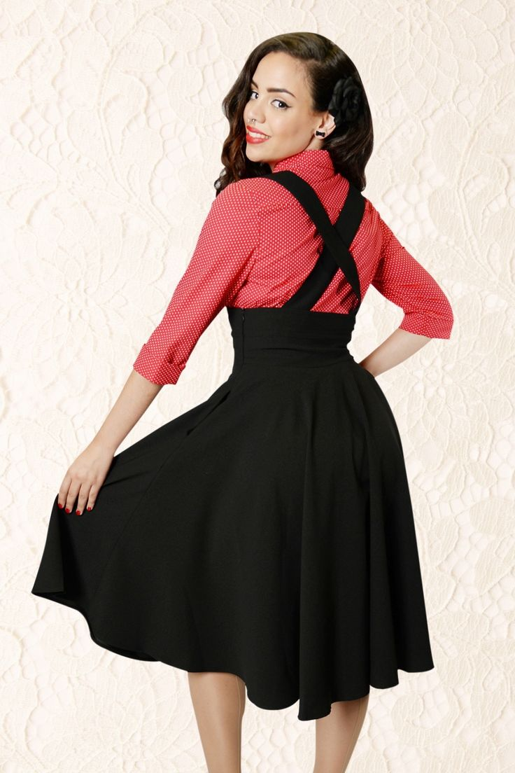 The50sMary Plain Swing Skirt in BlackbyCollectif Clothing is a playful high waist swingskirt with detachable and adjustable braces.The waist is beautifully emphasized by a cute rounded trim and gives you a gorgeous slim silhouette, vavavoom!The braces, which can also be crossed, create a playful effect, but can easily be detached, which makes it possible to wear this skirt in many ways. It runs into a flattering full circle skirt and hits below the knee wit...
