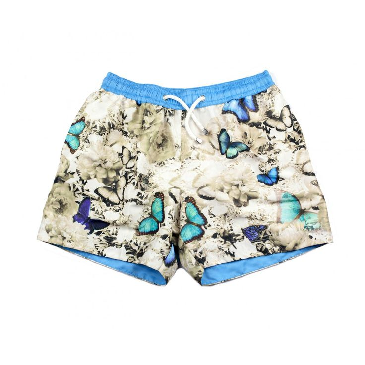 PARADISE BUTTERFLY SHORTS | The exclusive, graphic print swim shorts, 'Paradise' feature one of the designers favourite vintage inspired butterfly prints, using vibrant statement imagery, mixed with a subtle floral background. Shop the collection at thomasroyall.com