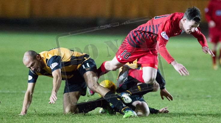 Queen's Park's Davis Galt is heavily tackled during the SPFL League Two game between Berwick Rangers and Queen's Park.