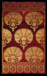 silk velvet ottoman yastik, probably 17thC, with graphic carnation motif and tulip borders